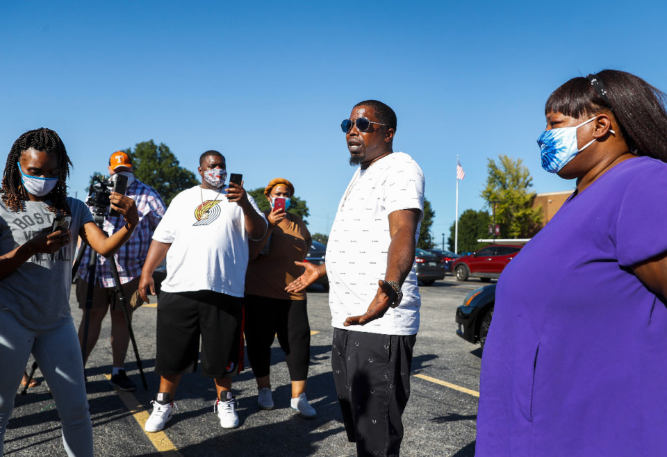 <strong>Shelby County Schools parent Casio Montez (middle) speaks during a parent rally asking for more virtual learning options due to the Delta variant, on Thursday, Sept. 9, 2021 outside SCS offices.</strong> (Mark Weber/The Daily Memphian)