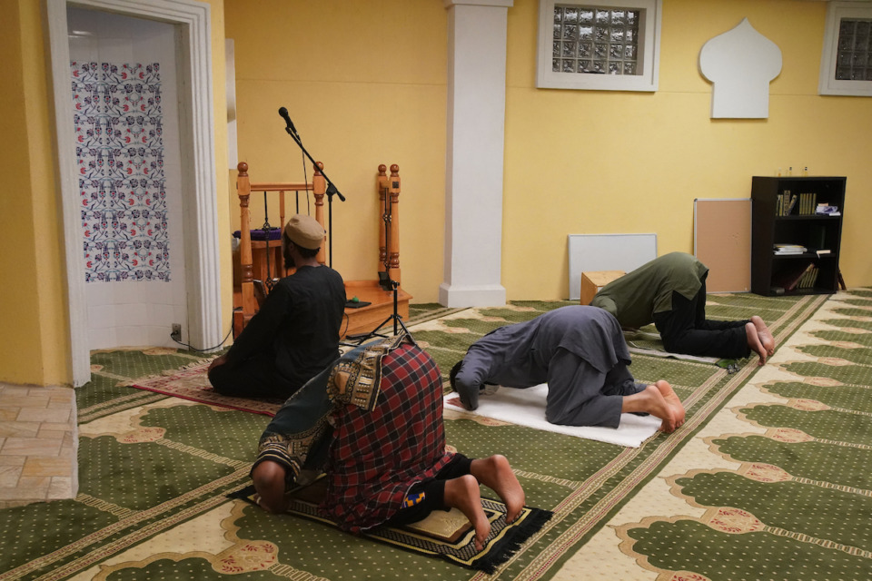 <strong>Midtown Mosque members pray during evening prayer on Sept. 3, in the Klondike neighborhood of North Memphis.</strong> (Karen Pulfer Focht/Special to the Daily Memphian)