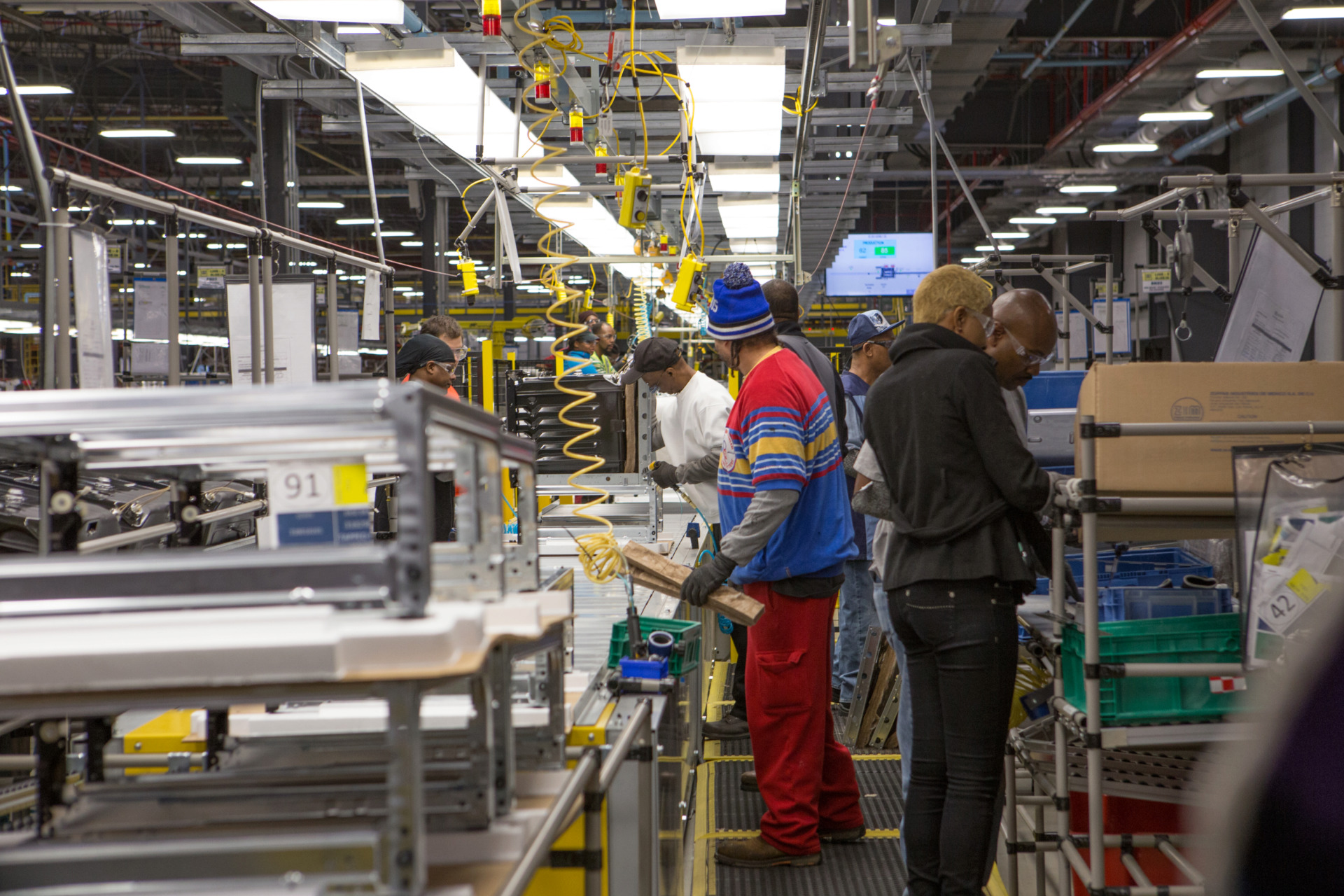 <strong>Electrolux workers man an assembly line at the company's Memphis manufacturing facility on Jan. 9, 2014. The Swedish appliance maker shed 55 percent of its workforce in 2018 and announced last week it would shutter the plant.</strong> (Daily Memphian file)