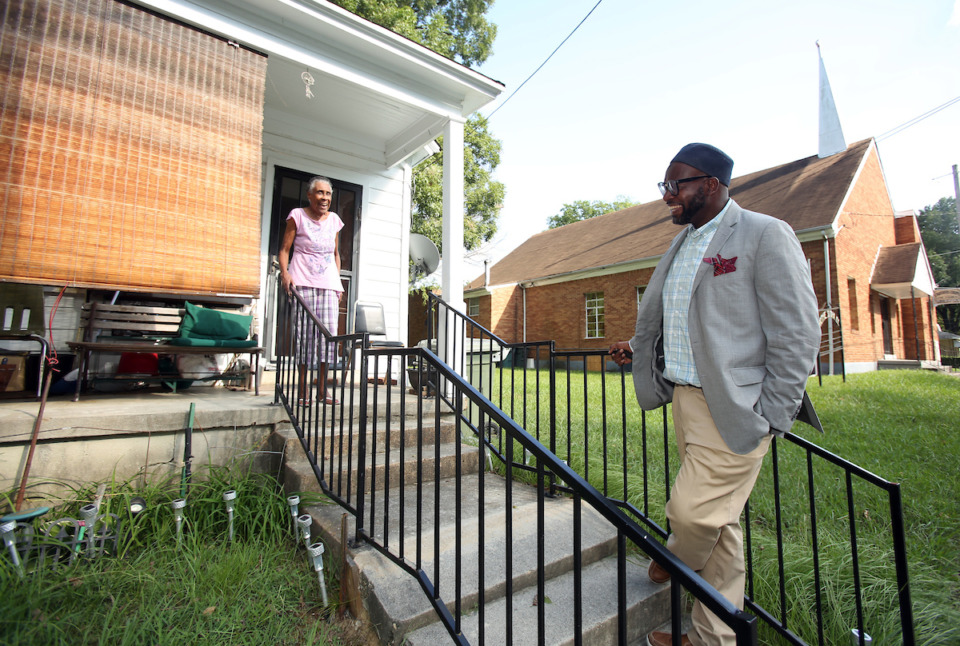 <strong>Property owner Mable Shaw, 84, is very invested in the Klondike neighborhood of North Memphis. Malik Shaw checks in with her occasionally when he walks the neighborhood.</strong> (Karen Pulfer Focht/Special to the Daily Memphian)