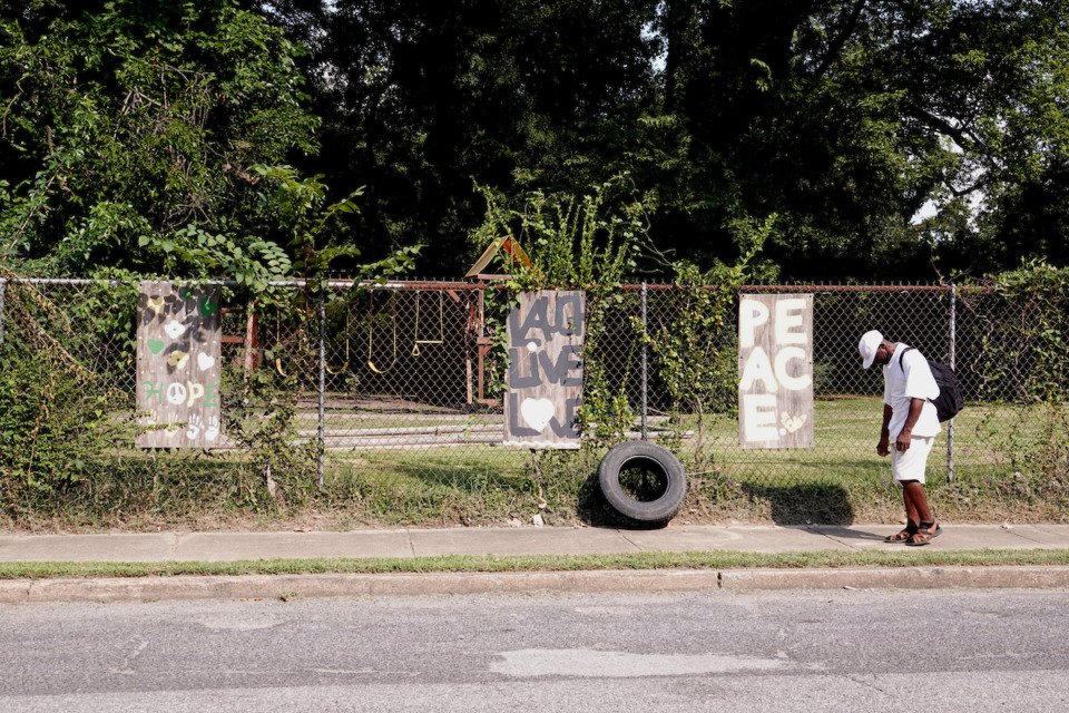 <strong>Building a park is one of the improvements made by Malik Shaw, who is working to make life better for the residents of the Klondike neighborhood</strong>.&nbsp;<strong>His daughter Miriam painted the signs that hang on the fence in front.</strong> (Karen Pulfer Focht/Special to the Daily Memphian)