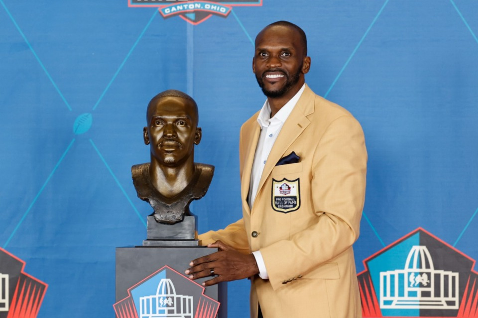 <strong>Isaac Bruce poses with his bust during the induction ceremony at the Pro Football Hall of Fame on Aug. 7 in Canton, Ohio. The Tigers will honor Bruce on Sept. 18.</strong>&nbsp;(Ron Schwane/AP)