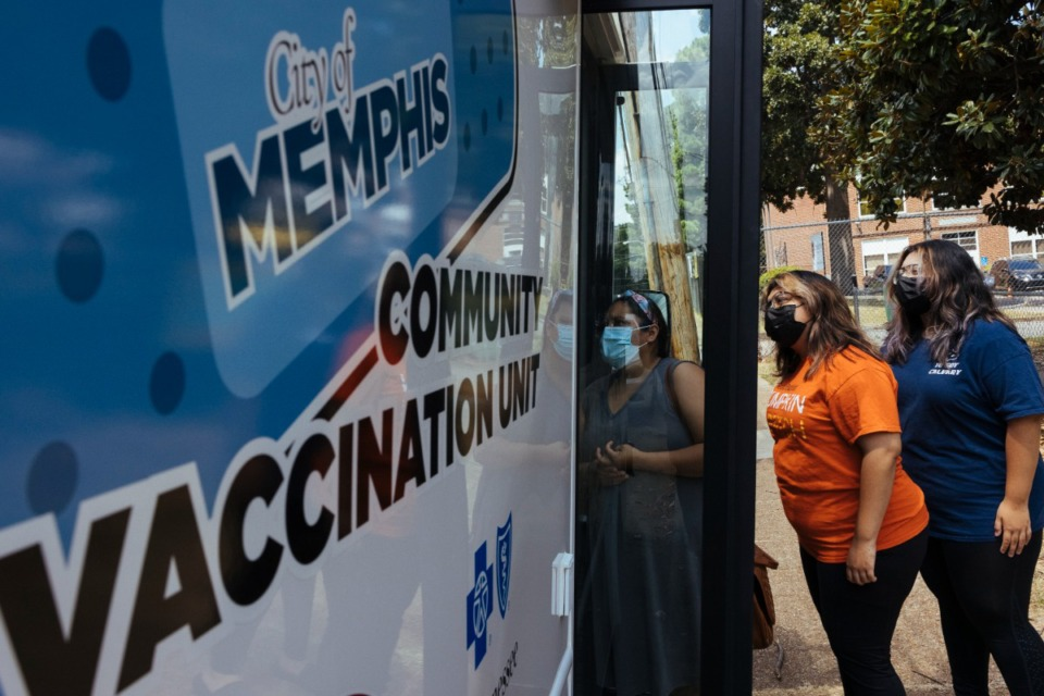 <strong>Members of the Gonzales family enter a mobile community vaccination unit to receive their choice of COVID vaccine at Carpenter Art Garden in Binghampton on Aug. 12.</strong> (Ziggy Mack/Special to The Daily Memphian file)