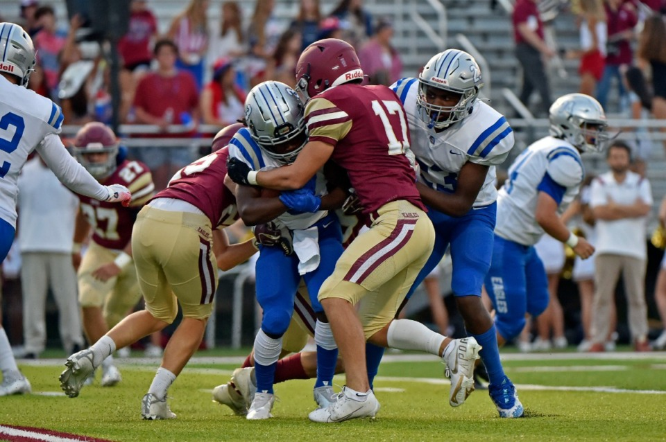 <strong>Evangelical Christian School&rsquo;s Zach Baker (17) tackles Jackson Christian&rsquo;s Kam Boyd at ECS on Sept. 10.</strong> (Justin Ford/Special to The Daily Memphian)