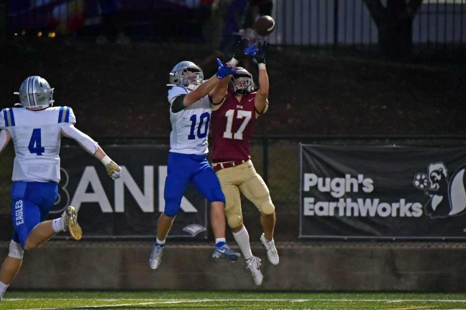 <strong>ECS&rsquo; Zach Baker (17) attempts to make a reception against Jackson Christian&rsquo;s Campbell Scott (10) at ECS on Sept. 10.</strong> (Justin Ford/Special to The Daily Memphian)