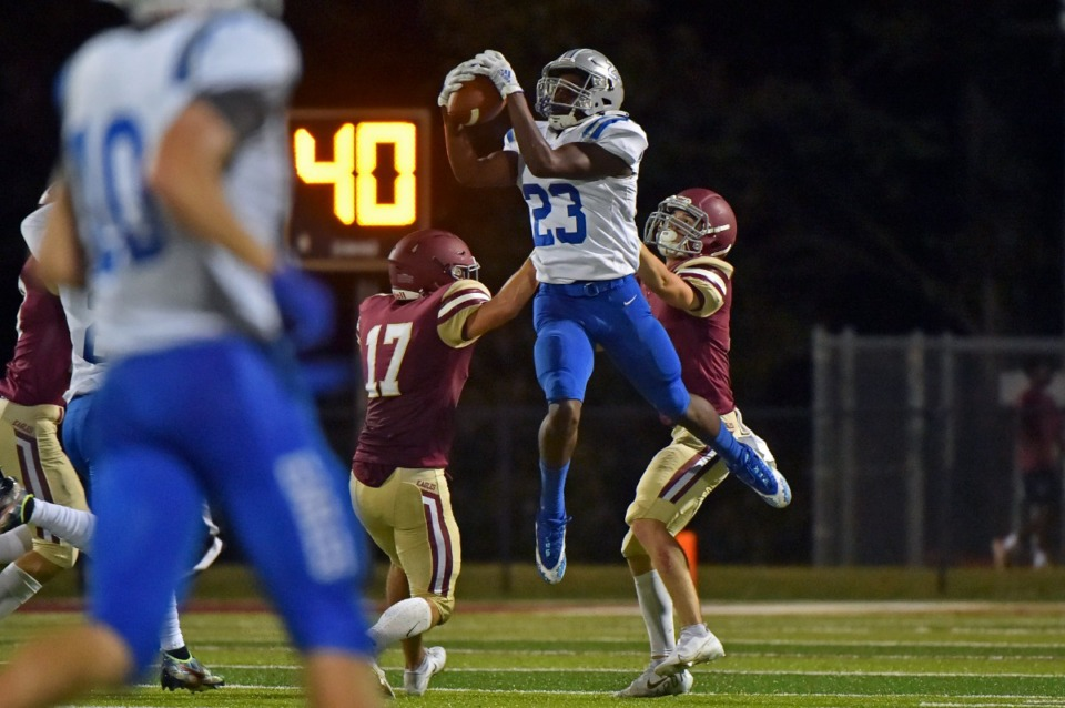 <strong>Jackson Christian&rsquo;s Jay&rsquo;Len Mosley (23) makes a reception despite ECS&rsquo;&nbsp;Zach Baker (17) at ECS on Sept. 10.</strong> (Justin Ford/Special to The Daily Memphian)
