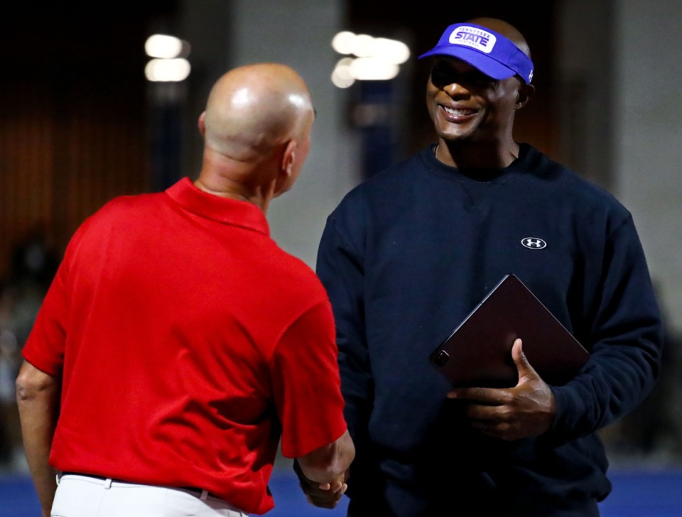 <strong>Bartlett High School coach Lance Tucker shakes hands with Tennessee State University coach and former Tennessee Titan Eddie George on Sept. 10.</strong> (Patrick Lantrip/Daily Memphian)