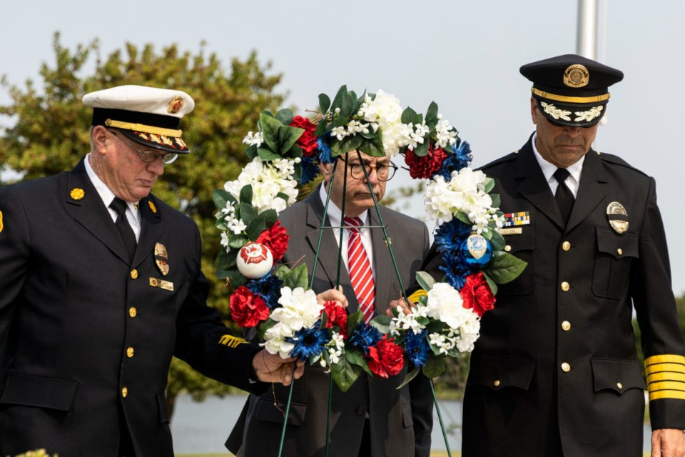 <strong>Bartlett Fire Chief Terry Wiggins (left), Bartlett Mayor Keith McDonald and Bartlett Chief of Police Jeff Cox lay a wreath during Bartlett&rsquo;s 9-11 Memorial Service at Bartlett&rsquo;s First Responders Monument.</strong> (Brad Vest/Special to Daily Memphian)