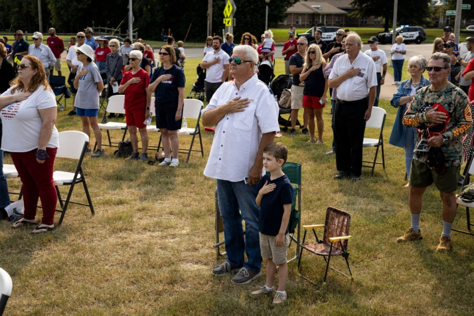 <strong>People stand for the Pledge of Allegiance during Bartlett&rsquo;s 9-11 Memorial Service at Bartlett&rsquo;s First Responders Monument.</strong> (Brad Vest/Special to The Daily Memphian)