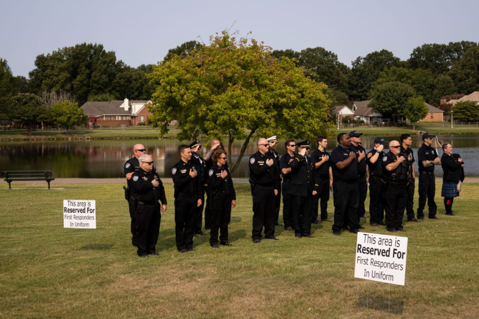 <strong>First responders stand for the Pledge of Allegiance during Bartlett&rsquo;s 9/11 Memorial Service at Bartlett&rsquo;s First Responders Monument.</strong> (Brad Vest/Special to The Daily Memphian)