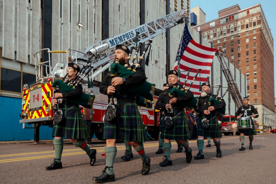 <strong>Wolf River Pipes and Drums lead a rememberance parade in Downtown Memphis on Saturday, Sept. 11, 2021.</strong> (Ziggy Mack/Special to The Daily Memphian)