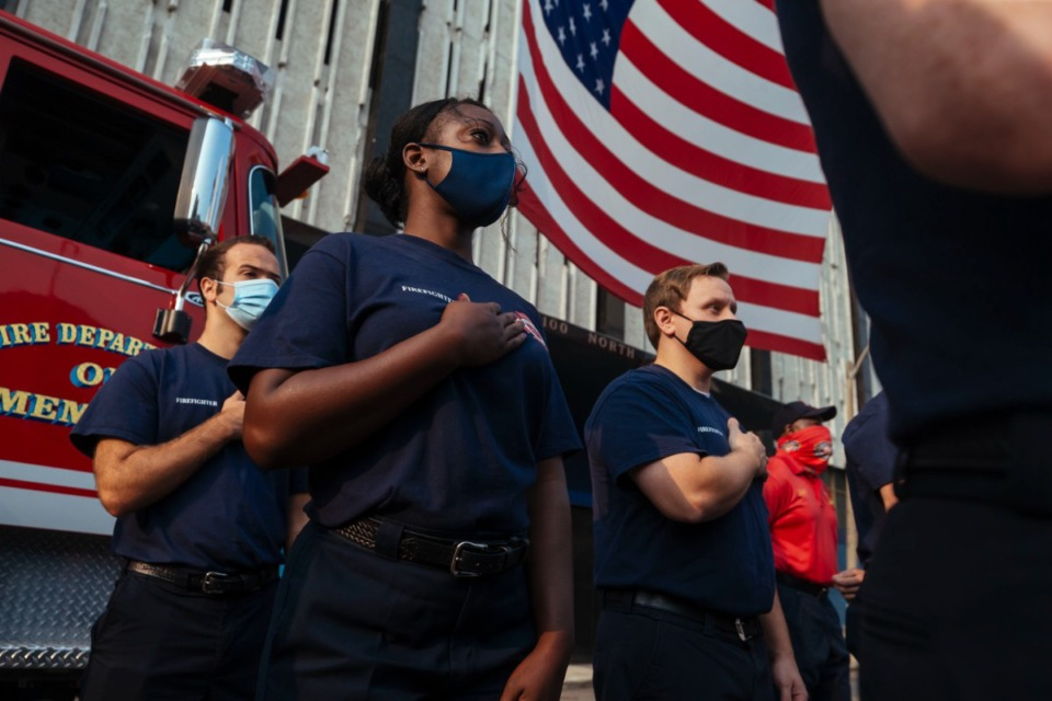 <strong>Memphis Fire Department employee pledge allegiance to the flag during a 9/11 rememberance service in Downtown Memphis, Saturday, Sept. 11, 2021.</strong> (Ziggy Mack/Special to The Daily Memphian)