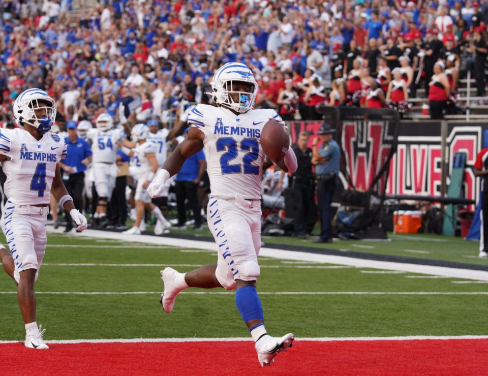 <strong>Running back Brandon Thomas (22)&nbsp;blasted 70 yards for a score, then topped himself with a 75-yard touchdown run.&nbsp;Wide receiver Calvin Austin III (4) caught 6 passes for 239 yards and three touchdowns Saturday as the Tigers defeated Arkansas State at Jonesboro. </strong>(Zach Wall/Memphis Football)