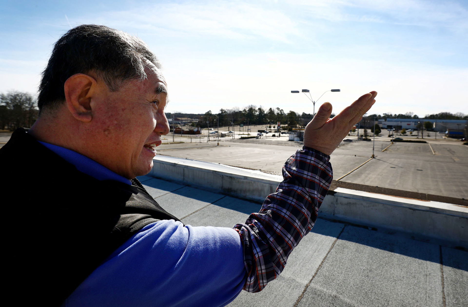 <strong>Ki Kim, owner of JD USA, a jewelry store adjacent to Southbrook Mall, has complained about mall customers and 18-wheel service trucks using his parking lot without permission. Kim says he owns the property and is seeking a special permit to make it a for-pay parking lot.</strong> (Houston Cofield/Daily Memphian)