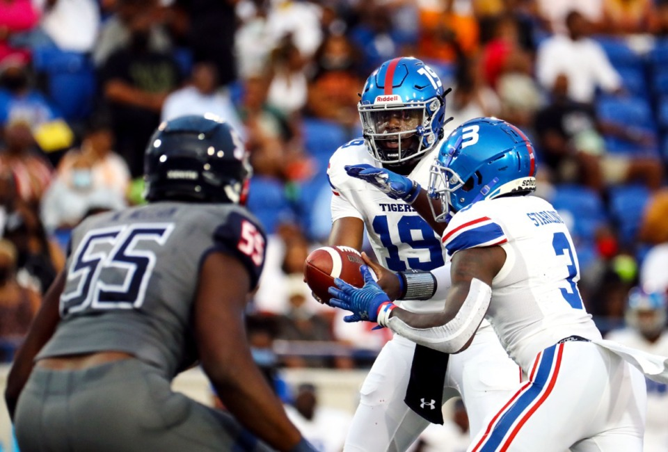 <strong>Tennessee State quarterback Geremy Hickbottom (19) hands the ball off during the Southern Heritage Classic in Memphis, Tennessee Sept. 11, 2021.</strong> (Patrick Lantrip/Daily Memphian)