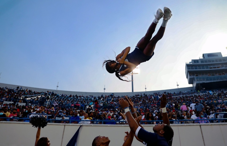 <strong>Jackson State cheerleader Essence Rentie gets tossed up in the air before the Southern Heritage Classic.</strong> (Patrick Lantrip/Daily Memphian)