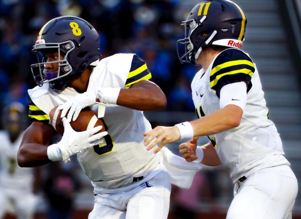 <strong>Lausanne Collegiate School running back Craig Cunningham (8) accepts a handoff from quarterback Brock Glenn (11) during a Sept. 10 game at Bartlett High School.</strong> (Patrick Lantrip/Daily Memphian)