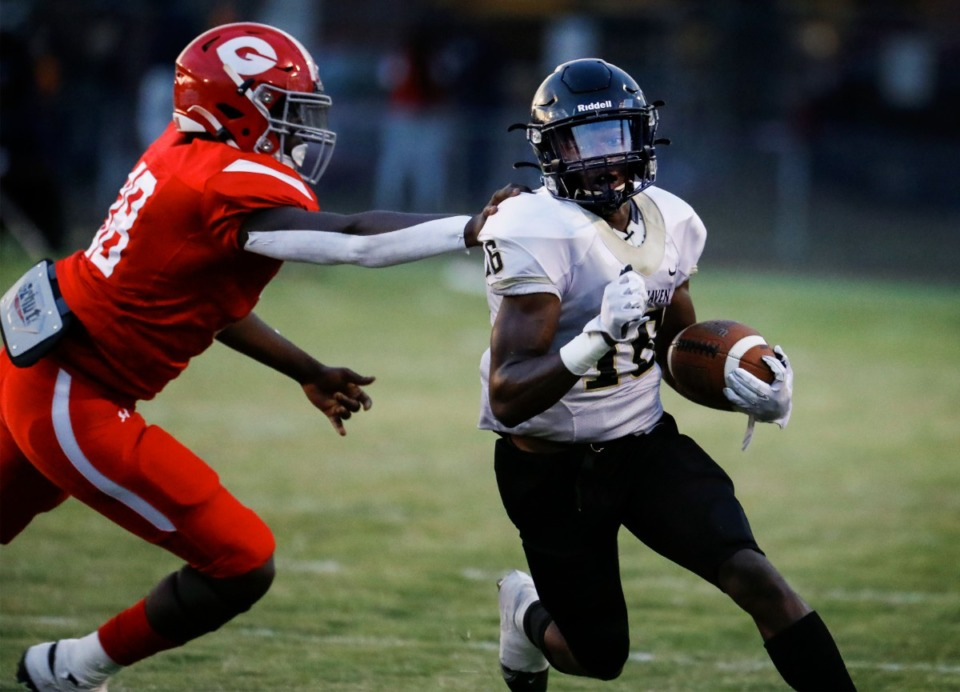 <strong>Whitehaven punt returner Markerious Johnson (right) runs by Germantown defender Quinton Brooks during action on Friday, Sept. 3, 2021. Whitehaven will face Houston this week, and Germantowm will play Bartlett.</strong> (Mark Weber/The Daily Memphian)