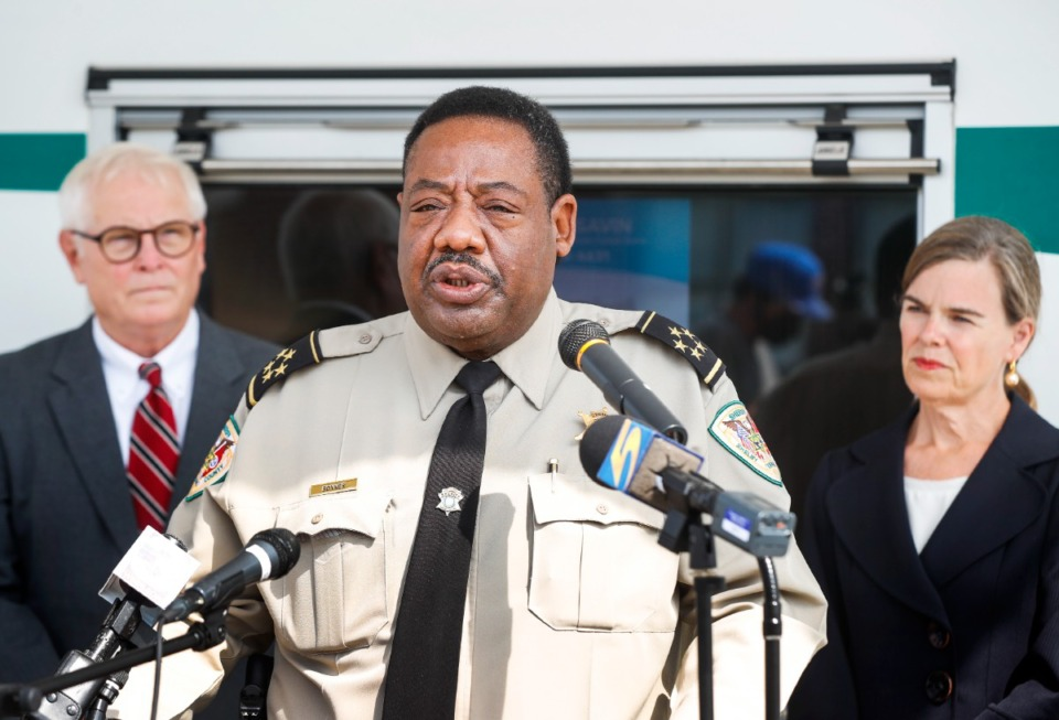 <strong>Shelby County Sheriff Floyd Bonner Jr. (middle) speaks at a press conference announcing a county-wide campaign promoting SAVIN, the Statewide Automated Victim Information and Notification system, on Monday, Sept. 13, 2021. Gary Cordell (left), SAVIN Program Coordinator of the Tennessee Sheriffs&rsquo; Association, and Amy Weirich (right), Shelby County District Attorney General, look on.</strong>&nbsp;(Mark Weber/The Daily Memphian)