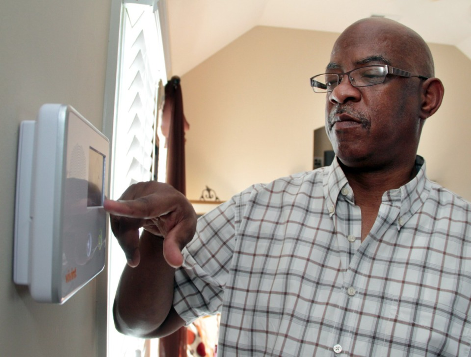 <strong>Lemuel Russell punches through the menu of his Vivint home security system. More than 6,900 people filed a complaint about home security systems at the Better Business Bureau in 2020.</strong> (Daily Memphian file)&nbsp;