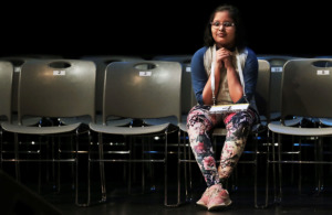 <strong>Simran Garg reacts after looking around at all the empty seats as she qualifies for the sixth round in the Shelby County Spelling Bee at the University of Memphis Michael D. Rose Theatre on Feb. 9, 2019. </strong>&nbsp;(Jim Weber/Daily Memphian)
