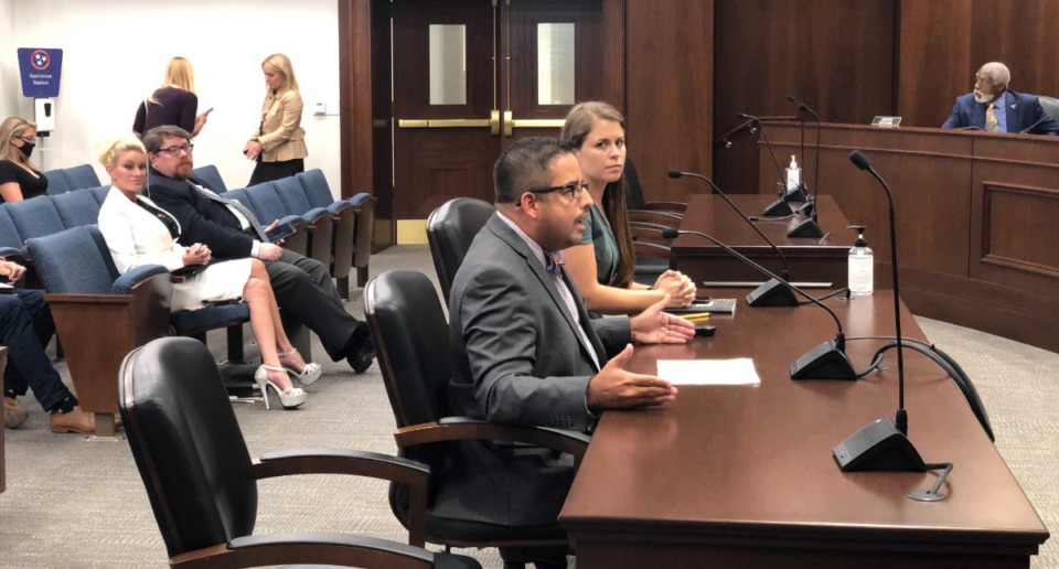 <strong>Willie Santana, law professor at Lincoln Memorial University in Knoxville, and Jasmine Heiss, of the Vera institute, discuss bail reform at a General Assembly committee meeting in Nashville on Sept. 13, 2021.</strong> (Ian Round/Daily Memphian)