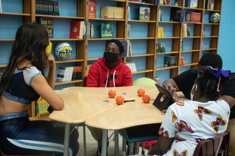 """<strong>Eighth-grader Malachi Harney said he read six books throughout the six-week """"Read to Achieve"""" challenge.</strong> (Daja E. Henry/Daily Memphian)"""