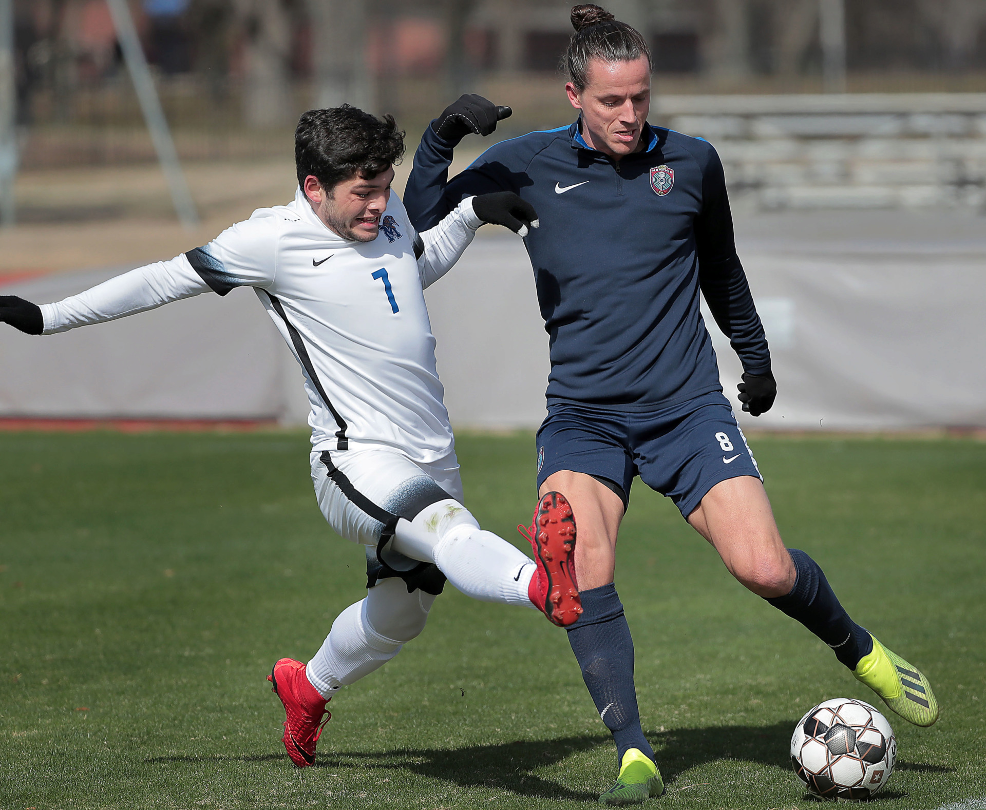 <strong>Memphis 901 FC defender Marc Burch passes under pressure by University of Memphis midfielder Edgar Alaniz during an exhibition game against the Tigers soccer team at the U of M south campus on Feb. 9, 2019.</strong> (Jim Weber/Daily Memphian)