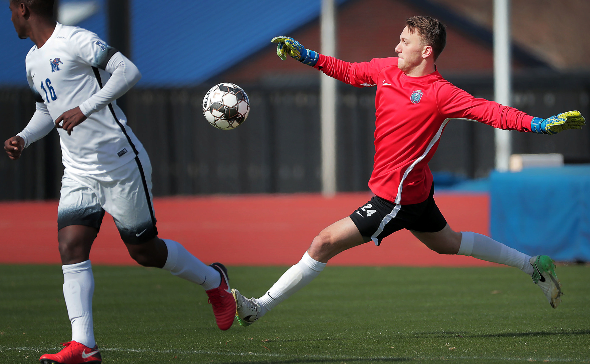 <strong>Memphis 901 FC Goalie Scott Levene clears the ball under pressure by University of Memphis midfielder Atakelti Gebregzabher during an exhibition game against the Tigers soccer team at the U of M south campus on Feb. 9, 2019.</strong> (Jim Weber/Daily Memphian)