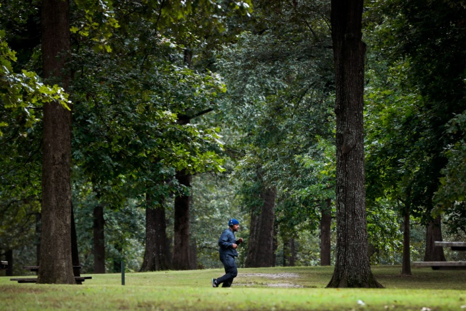 <strong>A jogger exercises in Audubon Park, which could be renamed DeCosta-Willis Park, on Sept. 15, 2021.</strong> (Mark Weber/The Daily Memphian)
