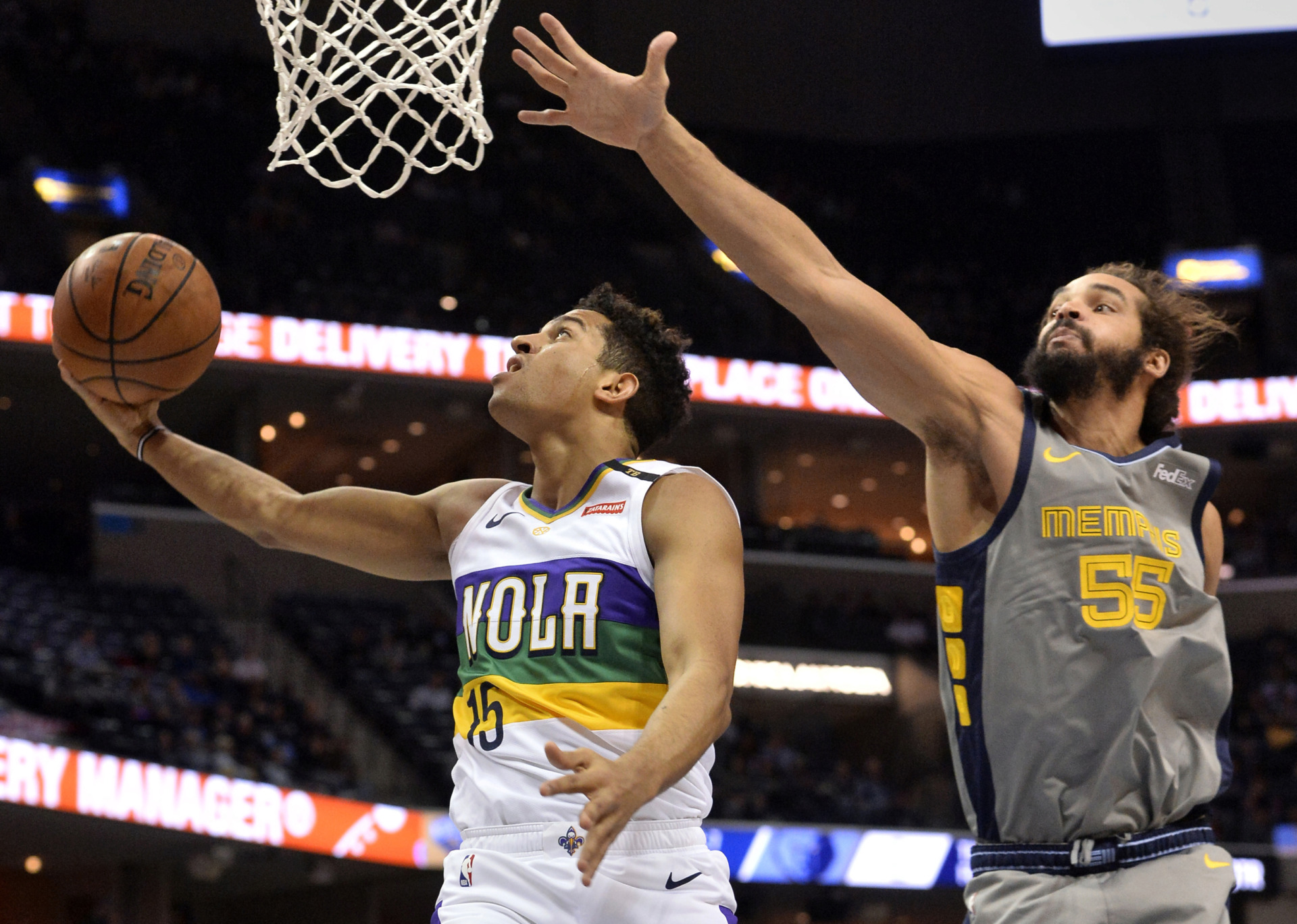 <strong>New Orleans Pelicans guard Frank Jackson (15) shoots next to Memphis Grizzlies center Joakim Noah (55) during the first half of an NBA game Saturday, Feb. 9, 2019, in Memphis.</strong> (AP Photo/Brandon Dill)