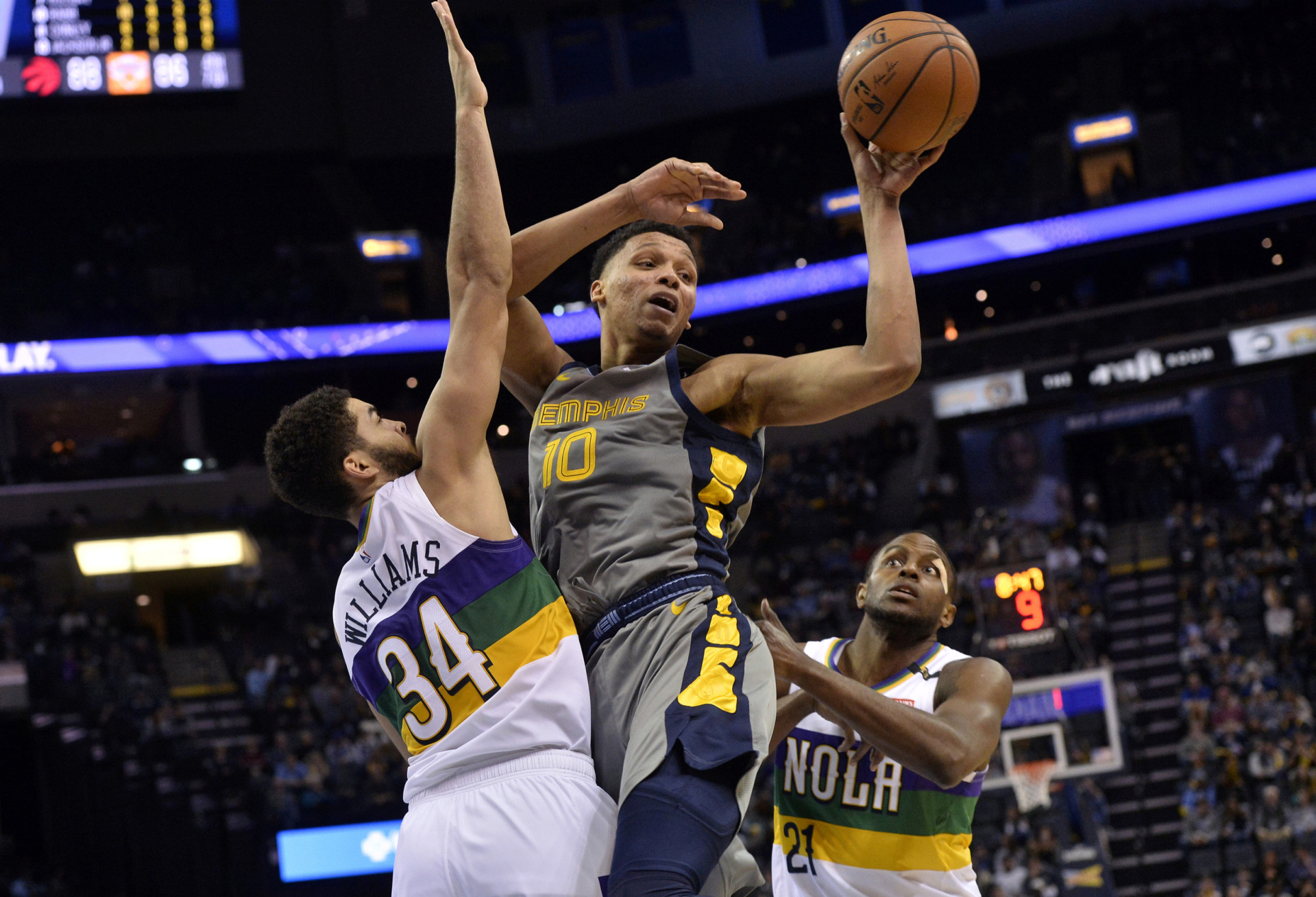 <strong>Memphis Grizzlies forward Ivan Rabb (10) handles the ball between New Orleans Pelicans guard Kenrich Williams (34) and forward Darius Miller (21) during the second half of an NBA game Saturday, Feb. 9, 2019, in Memphis.</strong> (AP Photo/Brandon Dill)
