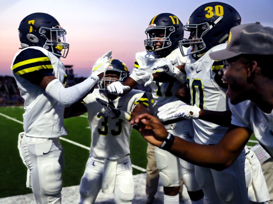 <strong>Lausanne Collegiate School players celebrate after a touchdown during a Sept. 10, 2021 game at Bartlett High School.</strong> (Patrick Lantrip/Daily Memphian)
