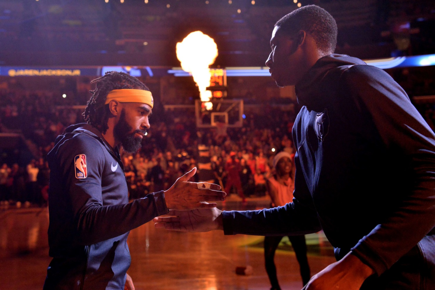 <strong>Memphis Grizzlies guard Mike Conley and forward Jaren Jackson Jr. greet each other during player introductions before an NBA basketball game against the Houston Rockets on Dec. 15, 2018, in Memphis.</strong> (Brandon Dill/Associated Press)