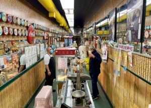 <strong>Rida AbuZaineh (right) tends to a customer in the peanut shop that is 8 feet wide on Main Street in Downtown Memphis.</strong> (Tom Bailey/Daily Memphian file)