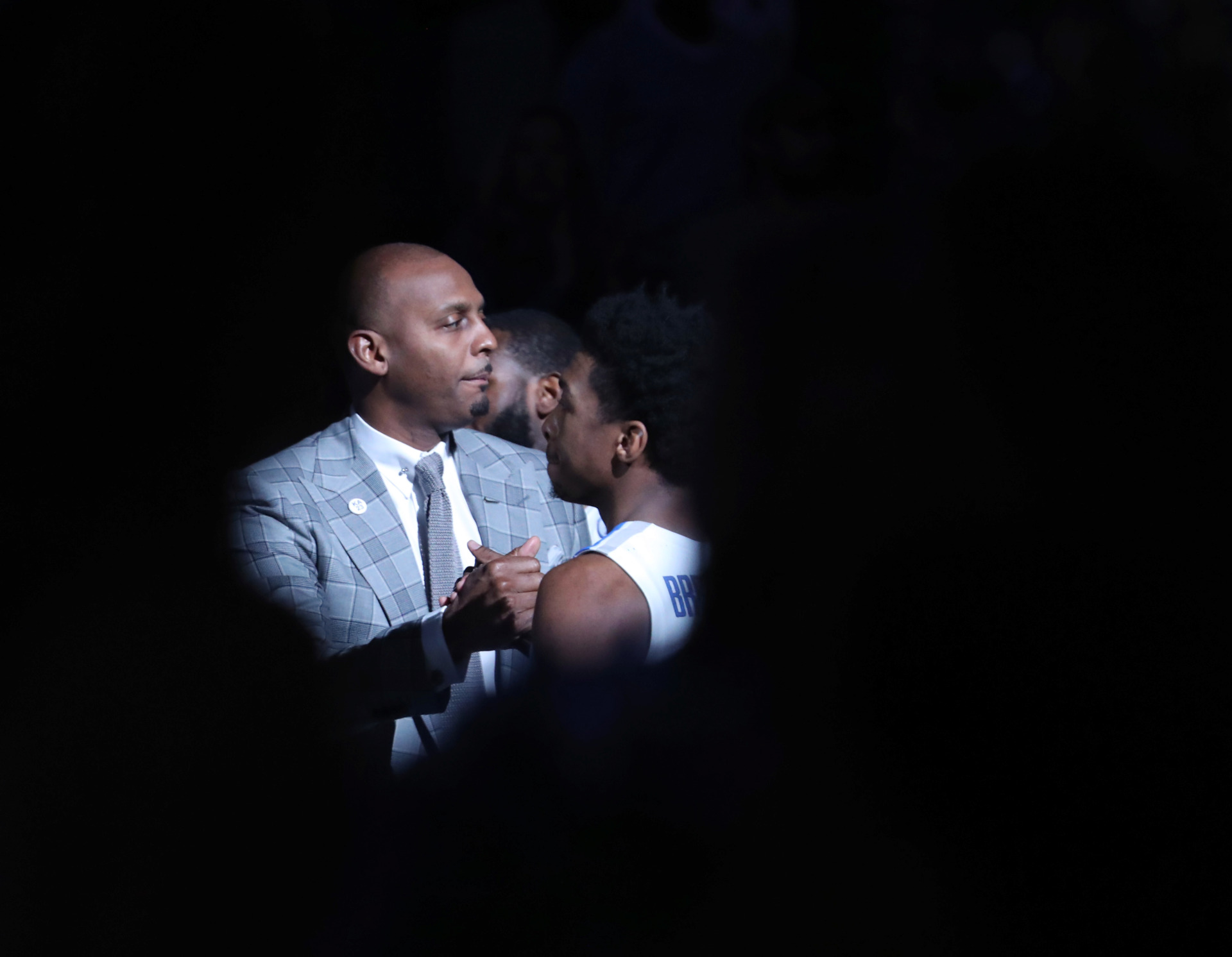 <strong>Memphis Tigers coach Penny Hardaway greets Kareem Brewton Jr. before the start of the game against Connecticut Huskies on Sunday, Feb. 10, at FedExForum. The Tigers went on to win, 78-71.</strong> (Karen Pulfer Focht/Special to the Daily Memphian)
