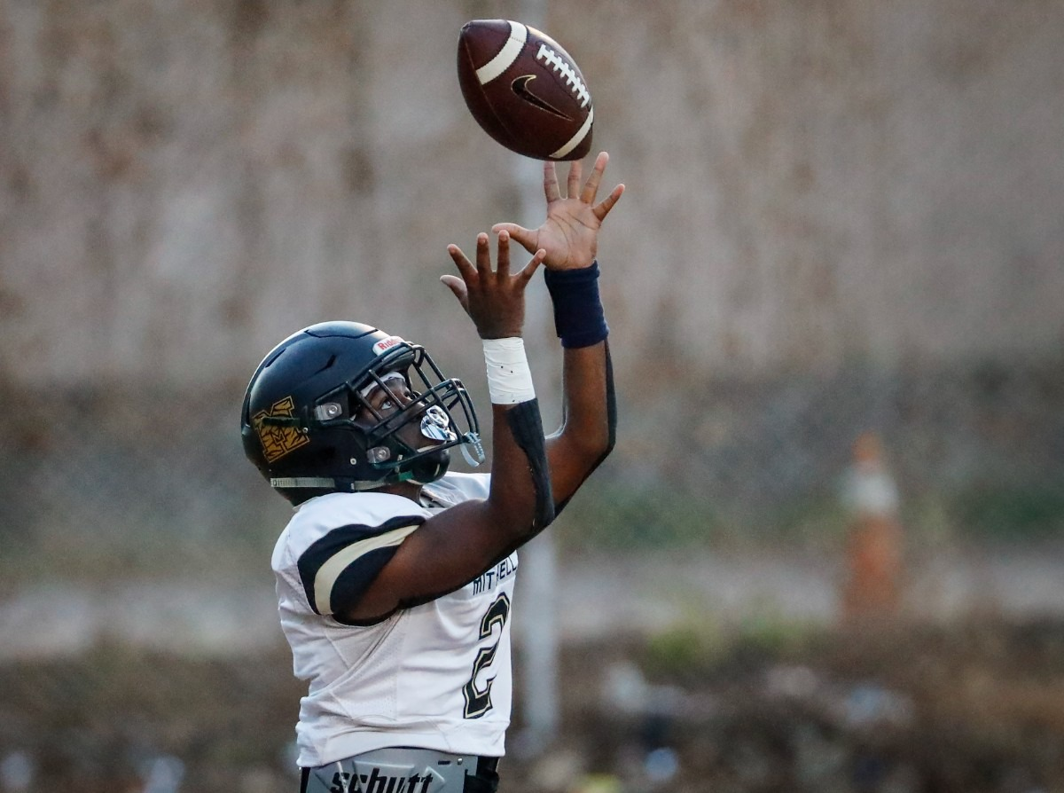 <strong>Mitchell quarterback Antonio Jenkins grabs a high snap in the game against MAHS on Thursday, Sept. 16, 2021.</strong> (Mark Weber/The Daily Memphian)