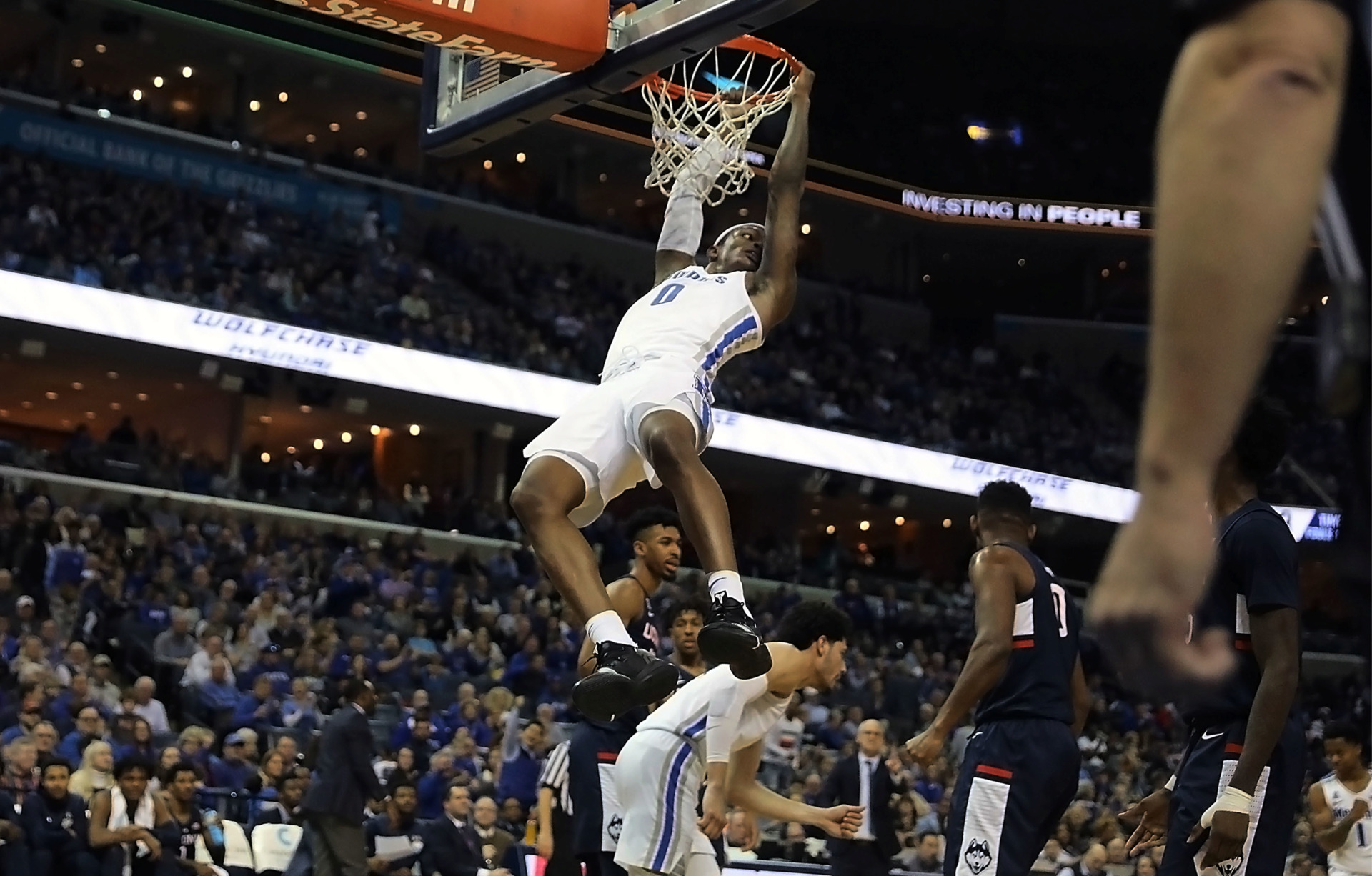 <strong>Kyvon Davenport brings the fans at FedExForum to their feet with a dunk in the first half against the Connecticut Huskies on Sunday, Feb. 10. The Tigers won, 78-71.</strong> (Patrick Lantrip/Daily Memphian)