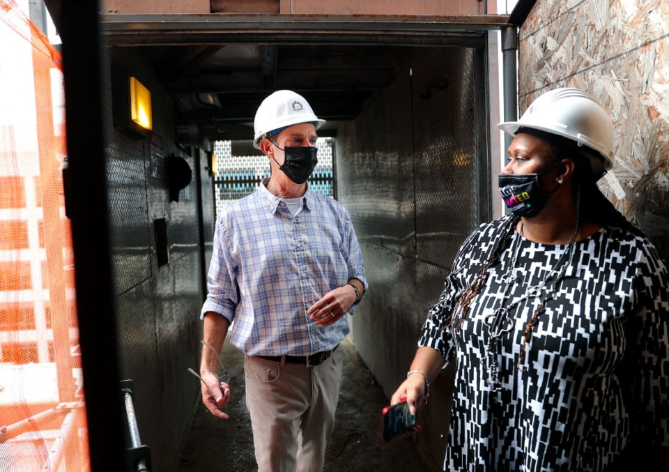 """<strong>William E. """"Billy"""" Orgel talks with Downtown Memphis Commission office manager Christine Taylor while giving a tour of 99 S. Front on Sept. 15, 2021.</strong> (Patrick Lantrip/Daily Memphian)"""