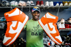 <strong>Snkrr Bar founder Dominique Worthen shows off a pair of restored Air Jordans at the recently opened business.</strong> (Mark Weber/The Daily Memphian)