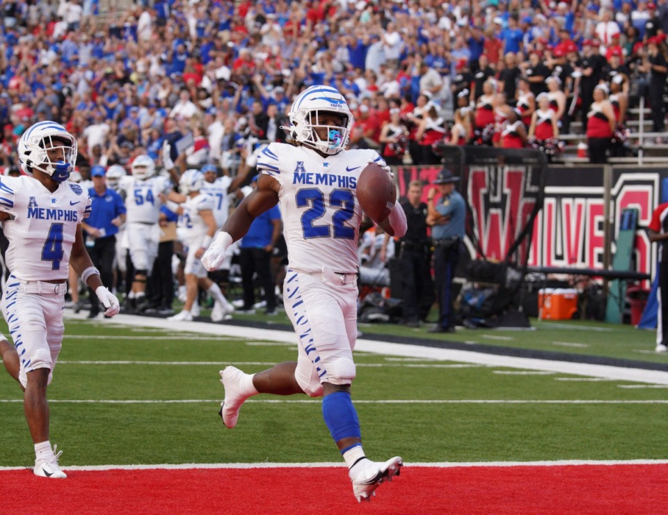 <strong>Running back Brandon Thomas (22) and wide receiver Calvin Austin III take the field Sept. 11 against Arkansas State at Jonesboro. Thomas rushed for 191 yards and two touchdowns in the game.</strong> (Zach Wall/Memphis Football file)