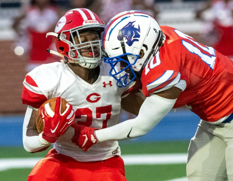 <strong>Germantown's Joshua Davis (27) is caught at the line of scrimmage by Bartlett's Devin Bullard (10) in Bartlett, Friday, Sept. 17, 2021.</strong> (Greg Campbell/Special to The Daily Memphian)