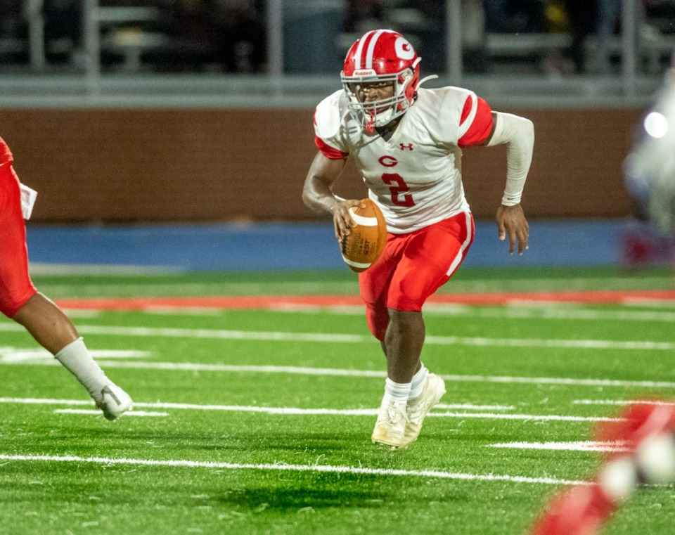 <strong>Germantown quarterback Malik Young (2) sprints upfield against Bartlett High School in Bartlett, Friday, Sept. 17, 2021. Young was the first to score in the game, on a short run at the goal line during the first half.</strong> (Greg Campbell/Special to The Daily Memphian)