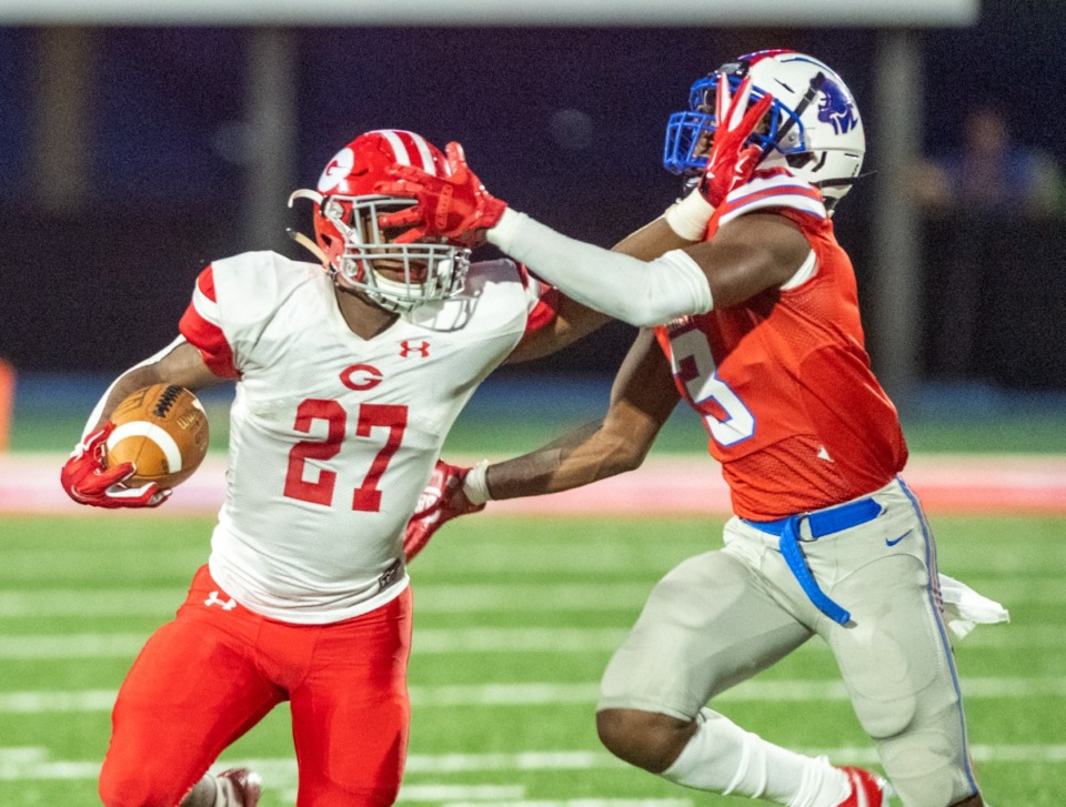 <strong>Bartlett's Marco Tyson (3) runs Germantown's Joshua Davis (27) out of bounds after a break to the outside. Germantown led at the half 7-0 in a mostly ground game, before going on to win 28-0.</strong> (Greg Campbell/Special to The Daily Memphian)