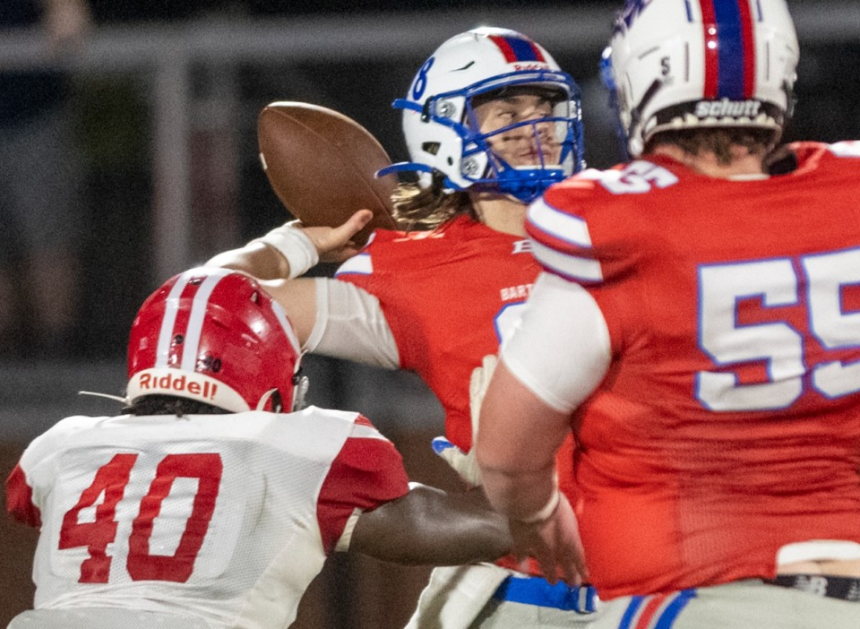 <strong>Bartlett quarterback Will Matthews (8) is pressured by Germantown's Evan McCleary (40) during Friday's game in Bartlett.</strong> (Greg Campbell/Special to The Daily Memphian)