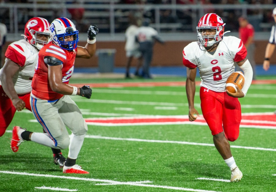 <strong>Germantown's quarterback, Malik Young (2), runs the ball against Bartlett on Sept. 17, 2021.</strong> (Greg Campbell/Special to The Daily Memphian)