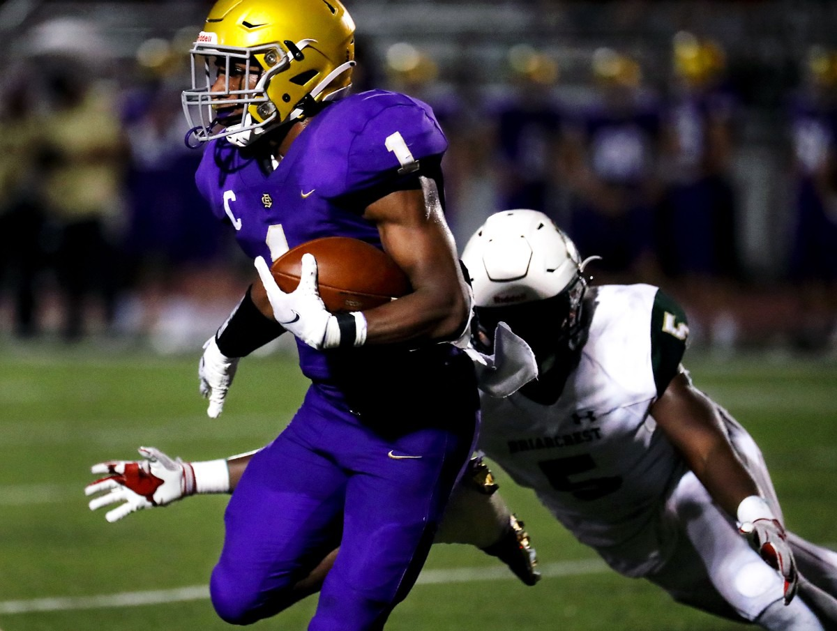 <strong>CBHS running back Dallan Hayden (1) evades a tackle during the Sept. 17 game against Briarcrest.</strong> (Patrick Lantrip/Daily Memphian)