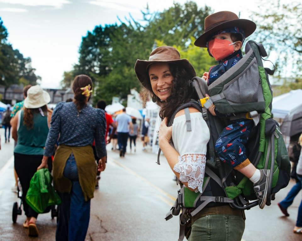 <strong>Jillian Atlas walks down Cooper Street with Oliver Tiberius Atlas in tow at Cooper-Young Festival in Midtown, Saturday, Sept. 18.</strong> (Ziggy Mack/Special to The Daily Memphian)