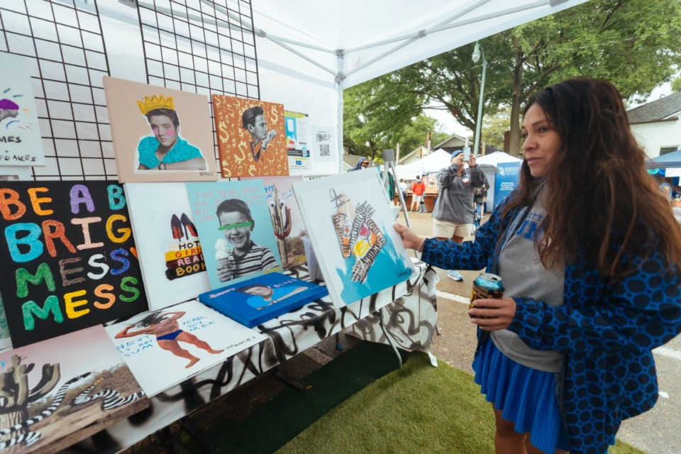 <strong>Cynthia Rodriguez peruses the Frances Berry Art booth.</strong> (Ziggy Mack/Special to The Daily Memphian)