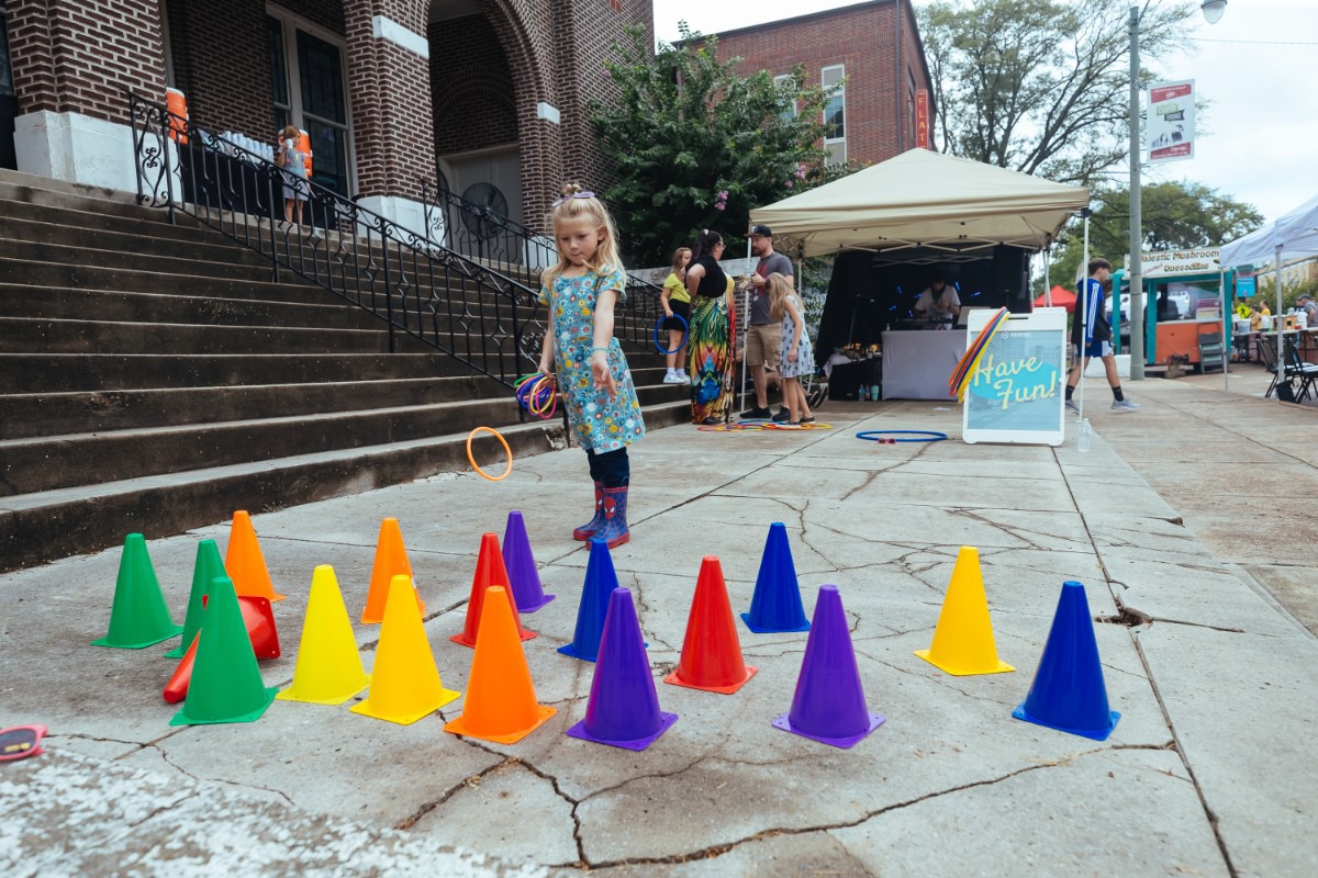 <strong>Averi Schaeffer plays with rings in front of Tabernacle Church at the Cooper-Young Festival.</strong> (Ziggy Mack/Special to The Daily Memphian)